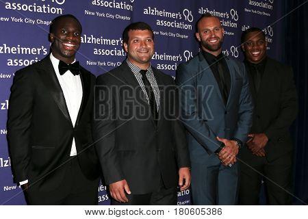 NEW YORK-JUN 8: (L-R) Prince Amukamara, Henry Hynoski, Mark Herzlick & Devon Kennard at Alzheimer's Association 2015