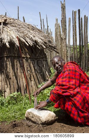 Chief Sharpening Knife In Krall In Maasi Village, Ngorongoro Conservationa Area, Tanzania