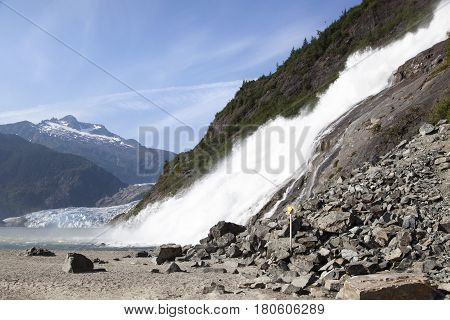 The view of Nugget Falls with Mendenhall Glacier in a background (Juneau Alaska).