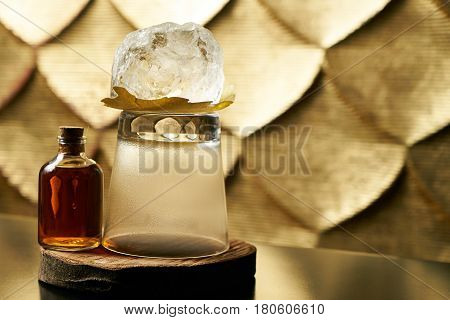 Close-up of a fresh branded alcoholic cocktail with ice and cognac and smoke in a Whiskey glass on a wooden birch bar counter. Concept of alcoholic and non-alcoholic bar beverage. Copy space.