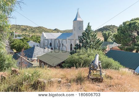 PHILIPPOLIS SOUTH AFRICA - MARCH 21 2017: View of the Dutch Reformed Church from a hill with a cannon guarding over Philippolis the oldest town in the Free State Province