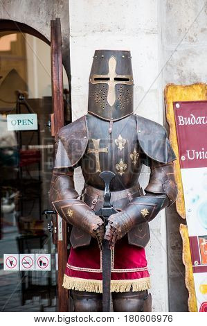 Budapest, Hungary - March 09, 2017: Dummy in knight armor with sword standing outside store in Fisherman's bastion in Buda castle