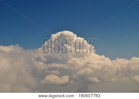 Saturated color of the blue sky with white clouds