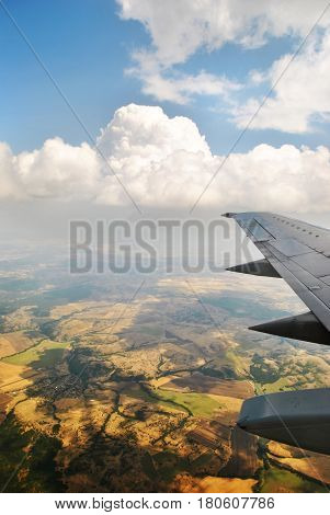 View of the airplane on the wing and sky and earth