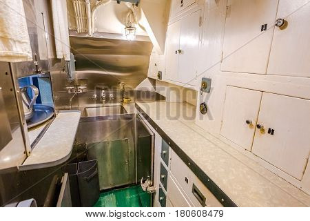 HONOLULU, OAHU, HAWAII, USA - AUGUST 21, 2016: kitchen room with sink of USS Bowfin Submarine SS-287 at Pearl Harbor. Historic Landmark of the Japanese attack in WW II.