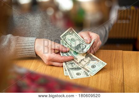 Man counts dollar notes. Part of the body - hands with money