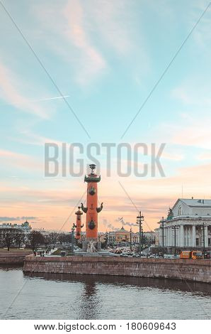 SAINT-PETERSBURG RUSSIA - december 2015: Winter panorama of Vasilievsky island spit - rostral columns Stock exchange building and Custom house. Historical Russian city with beautiful sunset sky background. Editorial use only