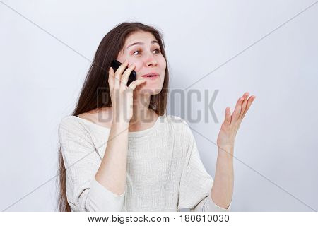 Young Woman Emotionally Talking On The Phone
