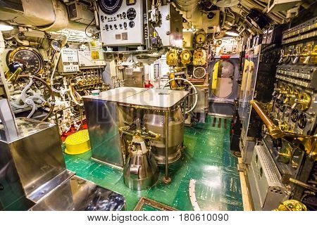 HONOLULU, OAHU, HAWAII, USA - AUGUST 21, 2016: machine engine room of USS Bowfin Submarine SS-287 at Pearl Harbor. With levers and measurement instruments of control.