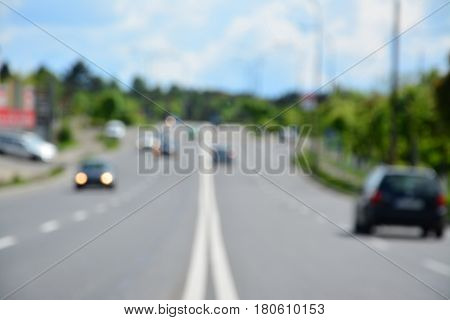 Blur image of road with less traffic in the distance bokeh from car lights aerial view.