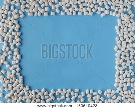 Marshmallows On Blue Background With Copyspace. Flat Lay Or Top View. Background Or Texture Of Color
