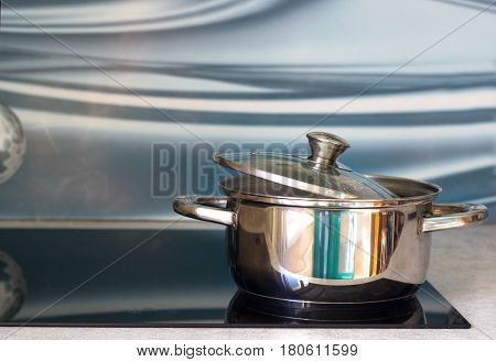Big pot in modern kitchen with induction stove.
