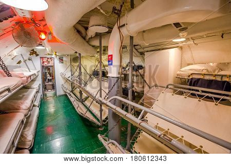 HONOLULU, OAHU, HAWAII, USA - AUGUST 21, 2016: sleeping room with camp beds of USS Bowfin Submarine SS-287 at Pearl Harbor. Historic Landmark of the Japanese attack in WW II.