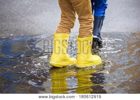 Happy Kids Jumping Under The Rain