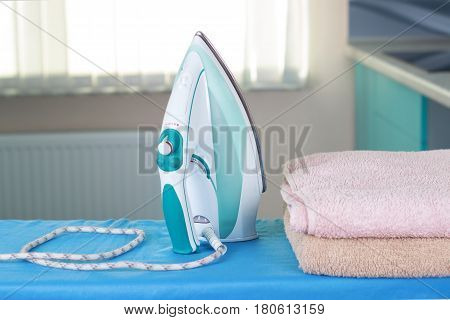 Housework ironing iron colorful towels on the ironing board