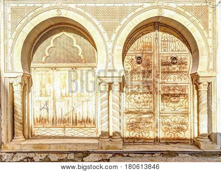 Traditional old painted door in a historical district or medina, Tunisia. Colorful textured image of muslim architecture. poster