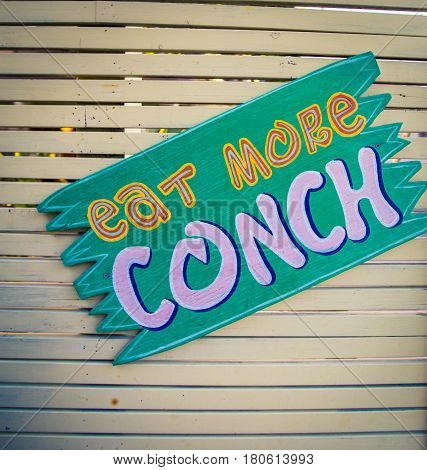 Eat more conch sign in Turks and Caicos poster