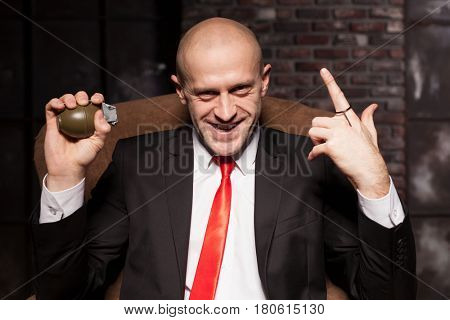 Killer in suit and tie ready to pull a grenade pin