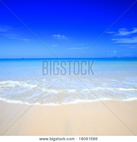 Beautiful beach with crystal clear blue waters  against blue sky