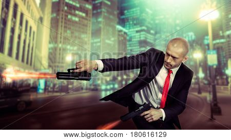 Bald assassin in suit and red tie shoot a pistols