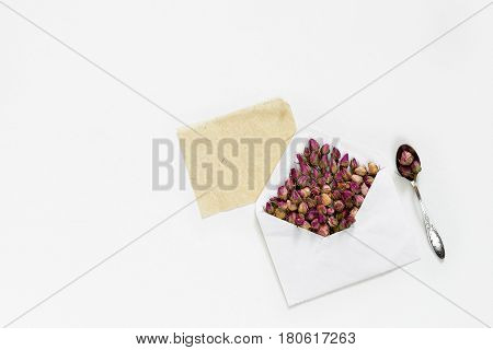 Purple dry tea roses in envelope and empty card for text on white background, flat lay, overhead view, backgroung mock up