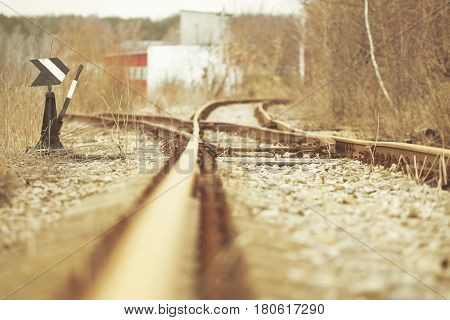 Manual railroad switch. Vintage rusty railroad landscape