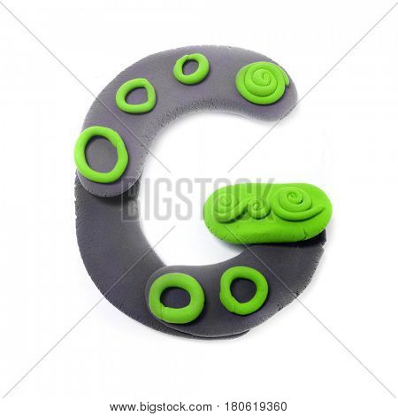 Plasticine letter G. Color plasticine alphabet, isolated.