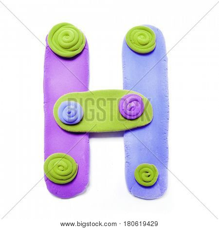 Plasticine letter H. Color plasticine alphabet, isolated.