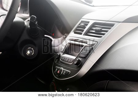 Control dashboard in a modern car. Car interior