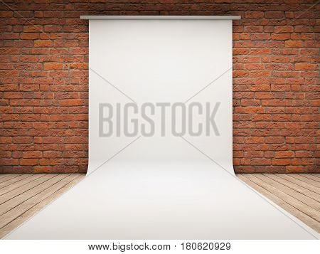 White backdrop on a brick room background