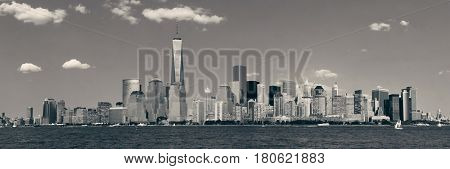 Manhattan downtown skyline with urban skyscrapers over river.