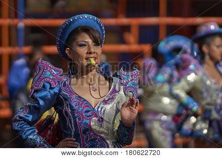 ORURO, BOLIVIA - FEBRUARY 26, 2017: Caporales dancers in ornate costumes performing as they parade through the mining city of Oruro on the Altiplano of Bolivia during the annual carnival.