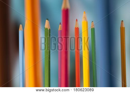 Macro composition of colored pencils standing upright