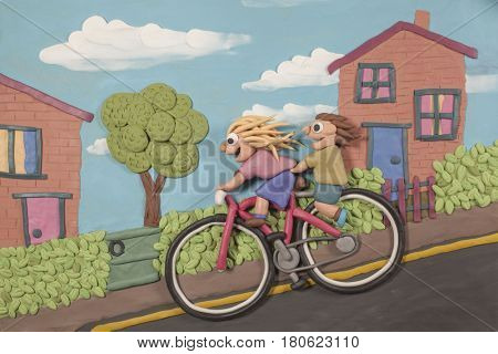 Modelling clay illustration of two children freewheeling down a hill on a large bicycle