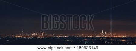 New York City skyline at night panorama and September 11 tribute light