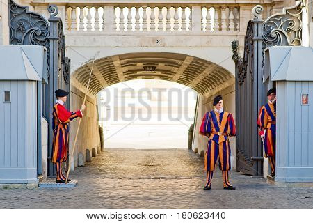 VATICAN - OCTOBER 5: Famous Swiss Guard guarding the entrance to the Vatican City on October 5, 2012 in Vatican, Rome The Papal Guard with about 100 men is the world's smallest army.