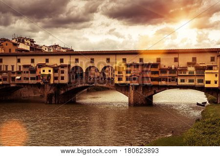 Ponte Vecchio over Arno river - famous old bridge in Florence, Italy