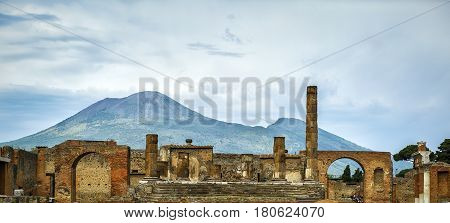 Panoramic view of the ruins of Pompeii, Iyaly.The Temple of Jupiter with Vesuvius in the distance. Pompeii is an ancient Roman city died from the eruption of Mount Vesuvius in 79 AD.