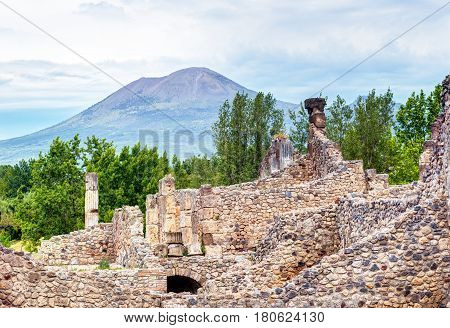Ruins of Pompeii with Vesuvius in the distance, Italy. Pompeii is an ancient Roman city died from the eruption of Mount Vesuvius in 79 AD.