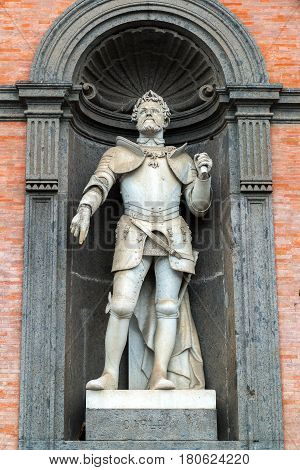 Statue of Emperor Charles V in a niche of the wall of the Royal Palace in Naples, Italy