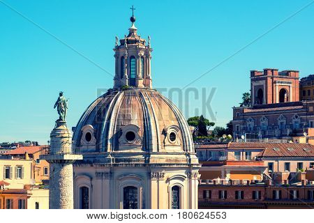 The old church and ancient Trajan's Column in Rome, Italy. Vintage Photo.