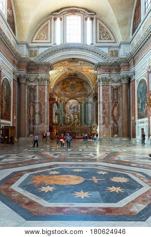 ROME, ITALY - MAY 8, 2014: Tourists visit the Basilica of St. Mary of the Angels and the Martyrs (Santa Maria degli Angeli e dei Martiri) built inside the Baths of Diocletian in the 16th century by Michelangelo.