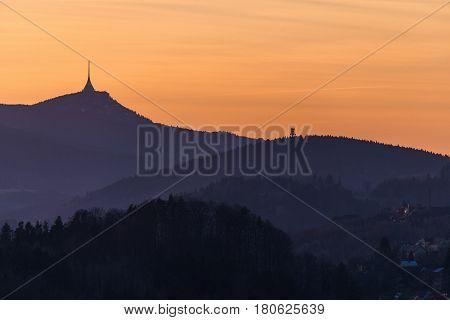Orange evening under the mountain Jested. Czech Republic