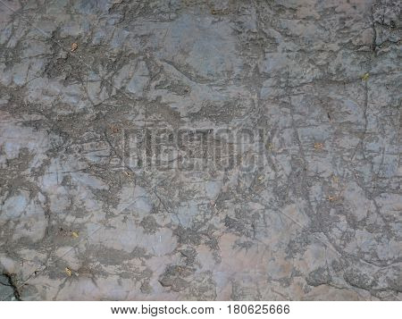 Old Stone Background Texture. Grey Rock Scratched With Marks, Relief Structure. Cobblestone Floor Or