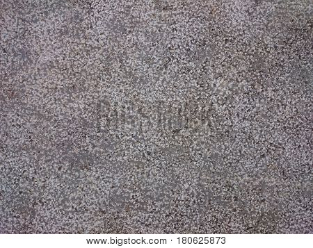 Grained stone background texture. Granite or concrete grey dotted pattern. Ruffle wall or floor rock.
