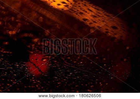 View of the modern city through the window on a very dark stormy night. Concept life of a modern city, urban traffic. Abstract background for banner design