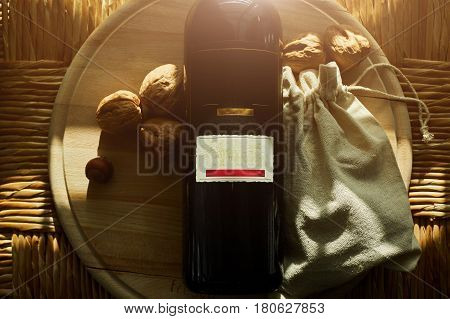 Red wine, walnuts on a wooden background