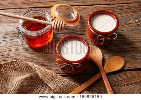 Curd dairy dessert with honey on wooden table