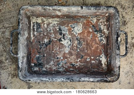 Mason bucket rectangular on debris background in house improvement