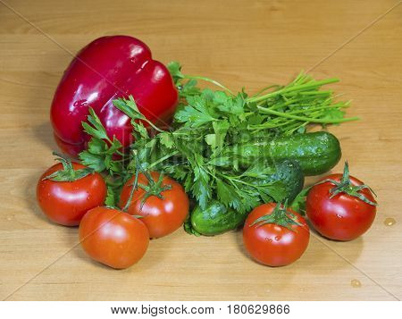The fresh vegetables on the wooden table